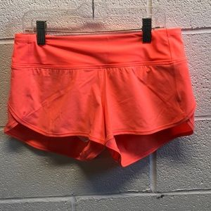Lululemon orange shorts, sz 4, 62786